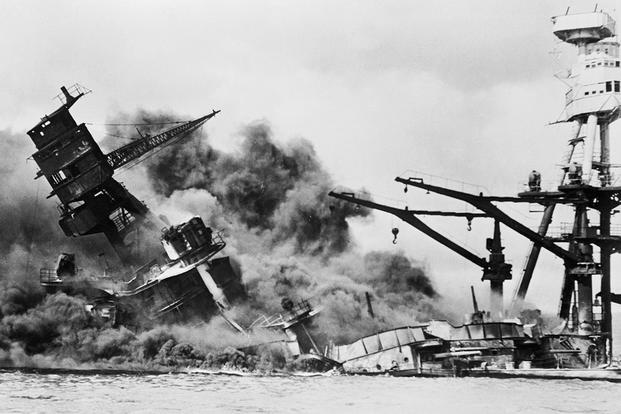 The battleship USS Arizona burns in the aftermath of Japan's surprise attack at Pearl Harbor on Dec. 7, 1941. More than 1,000 crew members were killed. (US Navy photo)
