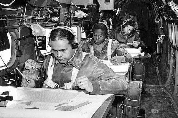 Tuskegee Airmen navigator cadets practice their skills in an airborne trainer in 1944. (National Archives)