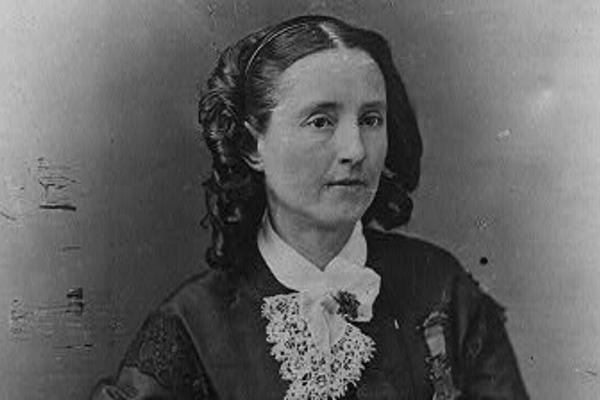 Mary E. Walker sitting in dress.
