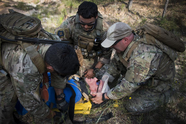 Airmen during a training exercise on victim stabilization.