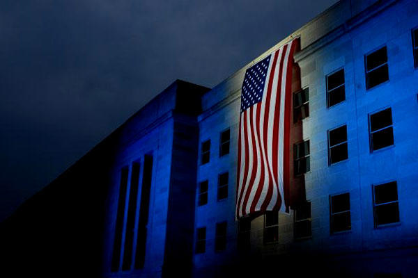 A memorial flag is illuminated on Sept. 11, 2007, near the spot where American Airlines Flight 77 crashed into the Pentagon on 9/11. (DoD/Brandan Schulze)