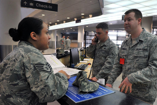 Staff Sgt. Jessicca Montague speaks with Staff Sgt. Nathan Ronimous, 731st Air Mobility Squadron passenger service supervisor, about Space-Available travel at the Osan passenger terminal, April 23, 2013. (Photo: U.S. Air Force)