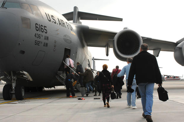 Space-A travellers are loaded into a C-17 headed for Dover Air Force Base, Del., April 21, 2008. (Photo: U.S. Air Force)