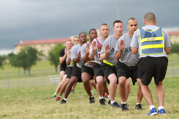 Soldiers in the Master Fitness Trainer Course step across Prichard Field June 5 as part of a warmup before physical readiness training. (Photo: Ms. Marie Berberea (TRADOC))