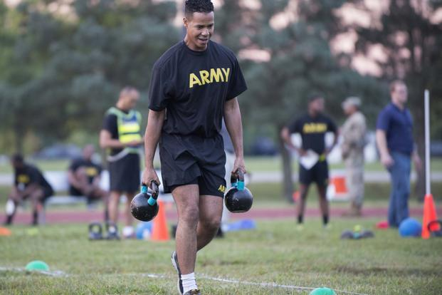 A Soldier carries two 40-pound kettlebell weights during a pilot for the Army Combat Readiness Test, a six-event assessment designed to reduce injuries and replace the current Army Physical Fitness Test (U.S. Army/Sean Kimmons)