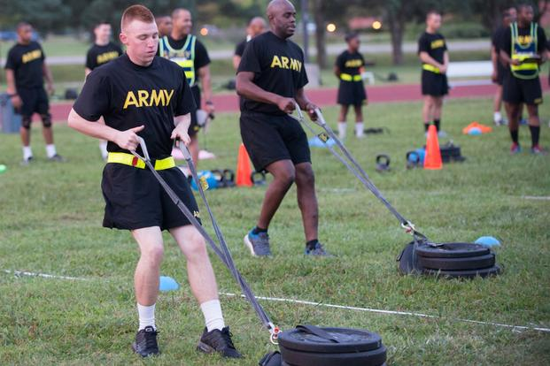 Pfc. Alex Colliver, front, pulls a 90-pound sled 50 meters that simulates the strength needed in pulling a battle buddy out of harm's way during a pilot for the Army Combat Readiness Test. (Photo Credit: U.S. Army photo by Sean Kimmons)