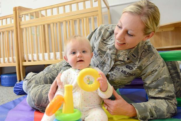 First Lt. Somer Lopez, 78th Force Support Squadron Customer Support chief, plays with baby. (U.S. Air Force photo by Tommie Horton)