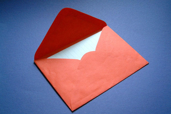 Red Valentine's day envelope with letter.