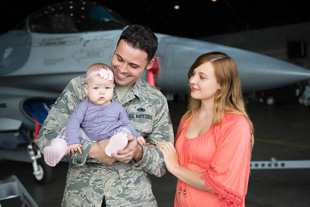 .S Air Force Staff Sgt. John Dunlap, his wife Jennifer and baby daughter Evelyn