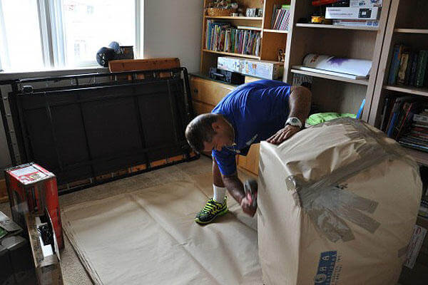 A mover wraps items in the Hunt household for a permanent change of station move.
