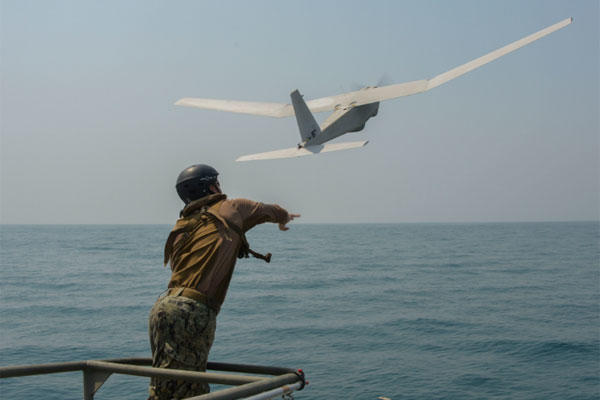 Electronics Technician 3rd Class Mitch Marema, assigned to Commander, Task Group 56.7.4, Coastal Riverine Squadron 4, launches a Puma AE unmanned aerial vehicle from a Riverine Command Boat. (U.S. Navy/Mass Communication Specialist 1st Class Peter Lewis)