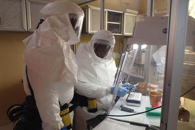 Technicians set up an assay test for Ebola within the U.S. Army Medical Research Institute of Infectious Diseases' containment laboratory, November 2014. (U.S. Army photo by Randal Schoepp, USAMRIID)