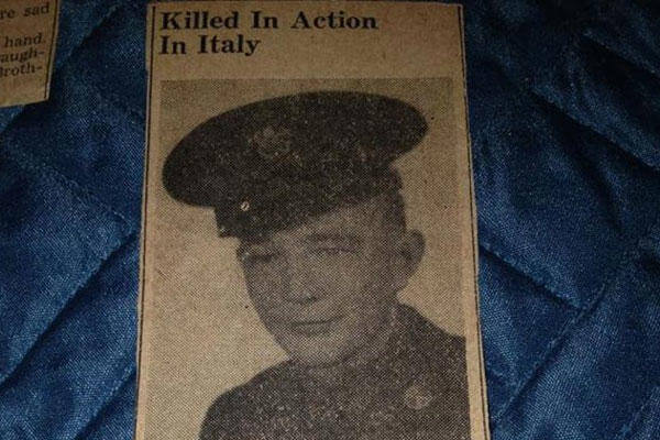 In this photo provided by Donna Gregory is an obit for Pfc. John Farrell Eddington.