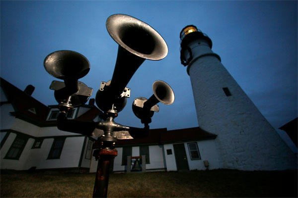 In this Monday, Dec. 22, 2014 photo, foghorns that were retired long ago remain aimed towards the sea at Portland Head Light in Cape Elizabeth, Maine. (AP Photo/Robert F. Bukaty)