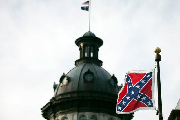A Confederate battle flag flies in front of the South Carolina statehouse Wednesday, July 8, 2015, in Columbia, S.C.  (AP Photo/John Bazemore)