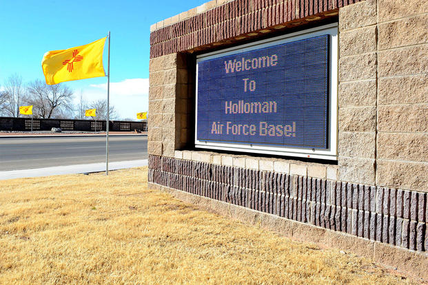 The New Mexico flag waves in the breeze at the front gate of Holloman Air Force Base. (U.S. Air Force photo/Airman 1st Class Deandre Curtiss)