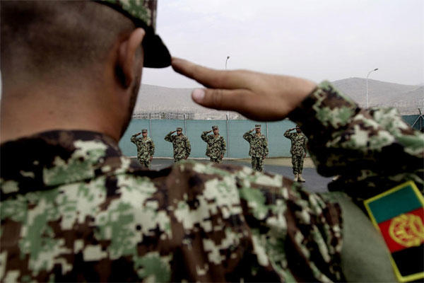 Afghan National Army officers salute during their inauguration ceremony at the Afghan Army Academy on the outskirts of Kabul, Afghanistan, Wednesday, Oct. 23, 2013. Army soldiers have easier access to education through this academy. Rahmat Gul / AP
