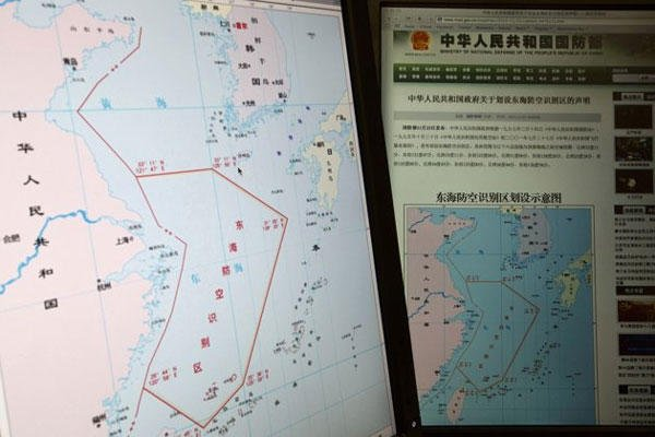 Computer screens display a map showing the outline of China's new air defense zone in the East China on the website of the Chinese Ministry of Defense, in Beijing Tuesday, Nov. 26, 2013.