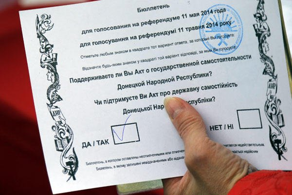 "A Ukrainian woman holds her referendum ballot paper with a mark in the ""yes"" field, in Moscow on Sunday, May 11, 2014. Many Ukrainians living in Moscow came to vote as well. (AP Photo/Dmitry Lovetsky)"