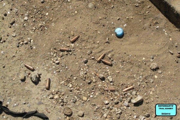 Associated Press - Defendants' Trial Exhibit DX2414, shows eight spent shell casings from the scene of the shootings of 14 Iraqi in Nisoor Square in Baghdad in 2007. (AP Photo)