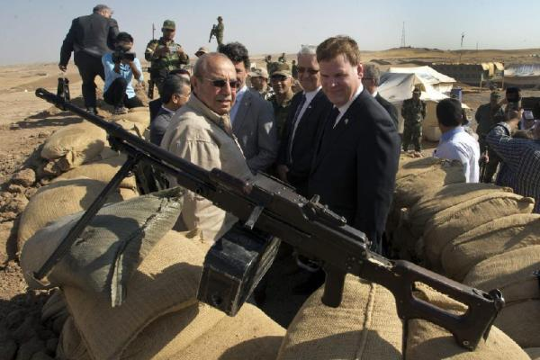 Canadian Foreign Affairs Minister John Baird, right, and Iraq Deputy Minister Rowsch Nouri Sharways stand at a front line bunker Thursday, Sept. 4, 2014 in Kalak, Iraq. (AP Photo Ryan Remiorz)
