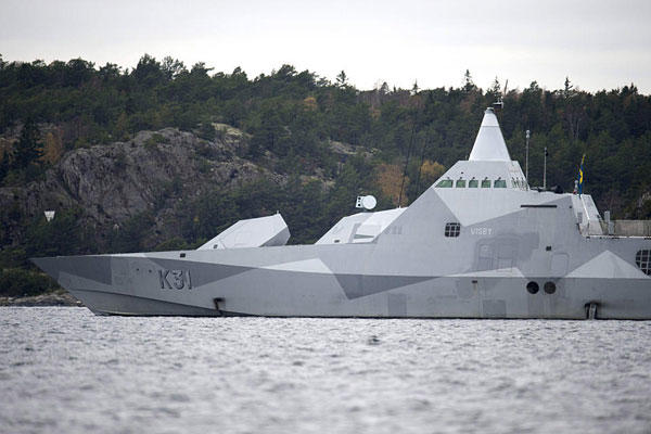 The Swedish corvette HMS Visby navigates on Mysingen Bay, as the search for a suspected foreign vessel entered its fifth day in the Stockholm archipelago, Oct. 21, 2014. AP Photo/TT News Agency, Fredrik Sandberg