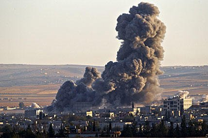 Smoke rises from an Islamic State position in eastern Kobani, after an airstrike by the U.S.-led coalition, seen from a hilltop outside Suruc, on the Turkey-Syria border Saturday, Nov. 8, 2014. Vadim Ghirda/AP