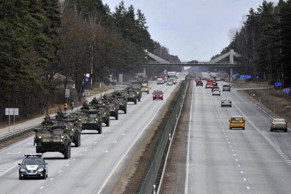 Stryker vehicles of the US Army's 2nd Cavalry Regiment roll the highway, during ''Dragoon Ride'' military exercise, in Riga, Latvia, Sunday, March 22, 2015. (AP Photo/Oksana Dzadan)