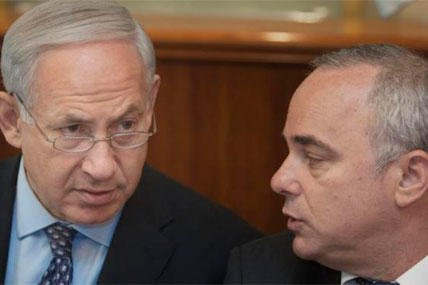 In July 30, 2012 file photo, Israeli Prime Minister Benjamin Netanyahu sits together with Finance Minister Yuval Steinitz, as they attend the cabinet meeting in his Jerusalem office. (AP Photo/Sebastian Scheiner, File)