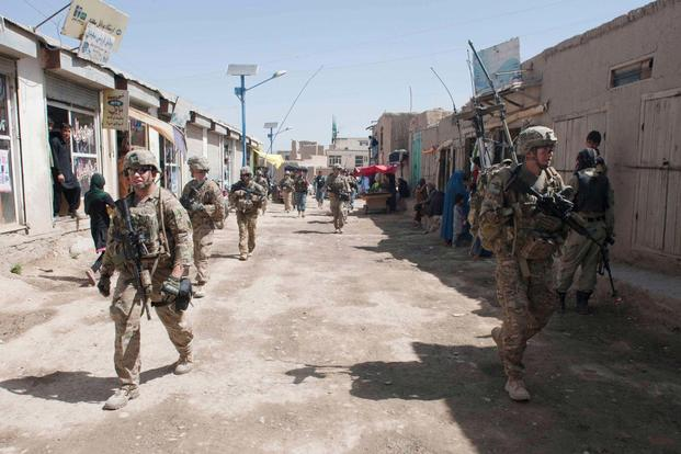 Soldiers assigned to the 3rd Infantry Division conduct a patrol and resupply mission with Afghan National Security Forces through Baraki Rajan in Logar Province, Afghanistan, May 22, 2013. (U.S. Army/Sgt. Julieanne Morse)