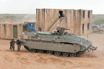 Soldiers maneuver around an Israeli Namer during the Ground Combat Vehicle assessment last month at Fort Bliss, Tex