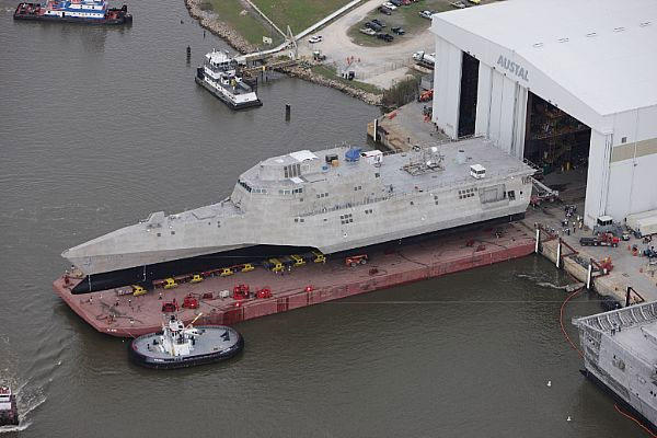 The littoral combat ship Pre-Commissioning Unit (PCU) Coronado (LCS 4) is rolled-out at the Austal USA assembly bay.