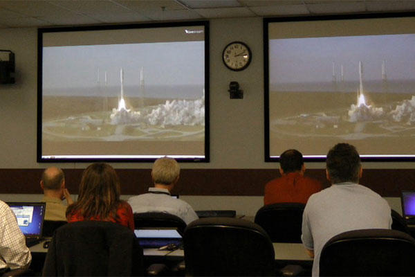 SPAWAR, PEO Space and PMW-146 personnel watch the launch of the Navy's first MUOS satellite at Cape Canaveral Air Force Base live from San Diego, Feb.24, 2012. (U.S. Navy photo by Rick Naystatt/Released)