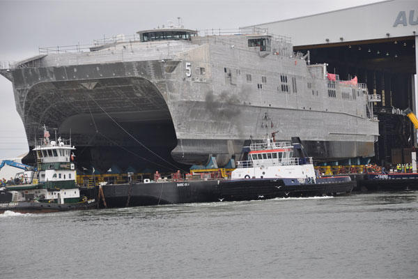 The future Military Sealift Command joint high-speed vessel USNS Trenton (JHSV 5) rolls out in preparation for launch at Austal USA shipyard. (U.S. Navy photo/Released)