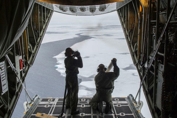 A Coast Guard C-130 launches an ocean-current probe as part of a Navy study on Arctic Ocean. (Navy photo)