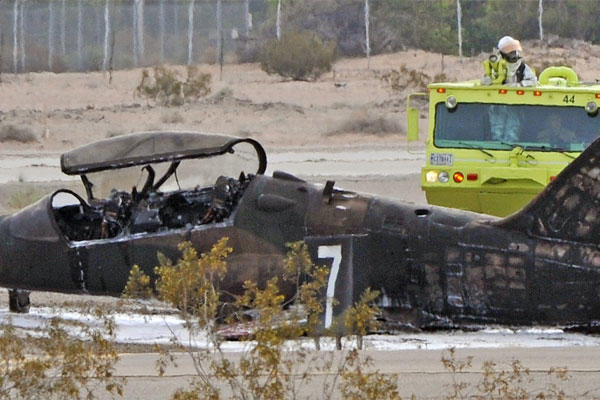 Officials check the scene of a T-59 Hawk aircraft crash Wednesday, March 11, 2015, at the Marine Corps Air Station in Yuma, Ariz. (AP Photo/The Yuma Sun, Randy Hoeft)