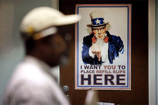 In this March 11, 2015 photo, a poster depicting Uncle Sam greets clients in a pharmacy waiting room at the Fayetteville Veterans Affairs Medical Center in Fayetteville, N.C.  (AP Photo/Patrick Semansky)