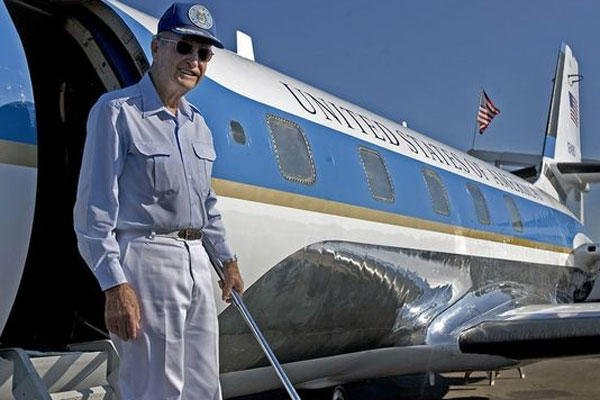 Retired Air Force Brig. Gen. Jim Cross stands on the steps of a JetStar that he flew for President Lyndon B. Johnson, in Austin, Texas. Cross died July 11 in Gatesville, Texas. He was 90.(Photo: Larry Kolvoord/AP)