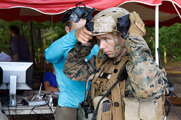 A Marine is fitted with the Augmented Immersive Team Trainer (AITT) from the Office of Naval Research during testing at Quantico, Va. (U.S. Navy/John F. Williams)