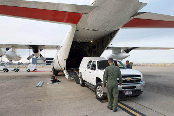 Members of Coast Guard Air Station Sacramento guide a FEMA vehicle up the ramp of the HC-130 for a Load-Out exercise at the air station on McClellan Air Force Base, Calif. (U.S. Coast Guard/Lt. j.g. Scott Handlin)