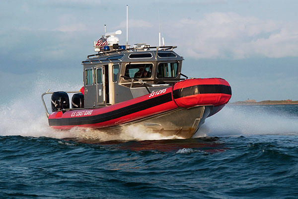 A 33-foot Special Purpose Craft - Law Enforcement boat from Coast Guard Station South Padre Island speeds through the water. (U.S. Coast Guard)