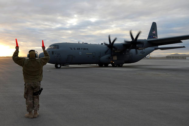 A U.S. Air Force Airman taxis a C-130J Super Hercules at Kandahar Airfield, Afghanistan, Jan. 12, 2013. (U.S. Air Force photo by Senior Airman Kayla Newman/Released)