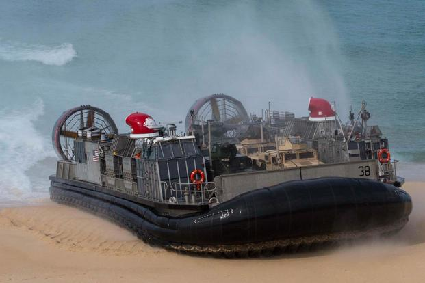 A landing craft air-cushion, or LCAC, transporting U.S. Marines and Portuguese Marines lands at Pinheiro Da Cruz, Praia Da Raposa beach, Portugal, to participate in a combined amphibious assault exercise, Oct. 20, 2015. (Photo by: Sgt. Austin Long)
