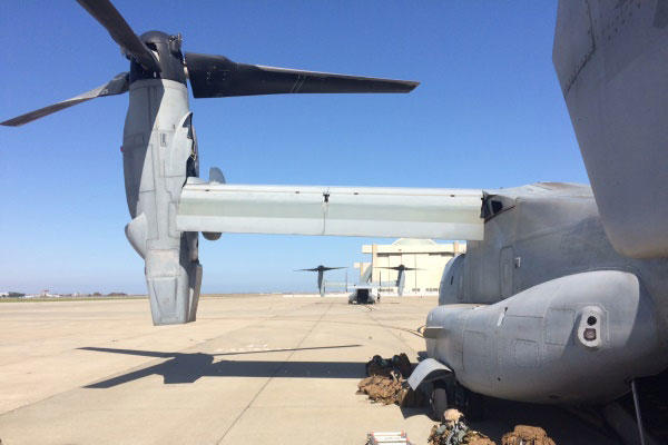 A pair of Marine Corps MV-22 Osprey tilt-rotor aircraft sit on the flight line on Tuesday at Moffett Field in California for a training exercise involving FEMA officials as part of Fleet Week San Francisco. (Photo: Military.com)