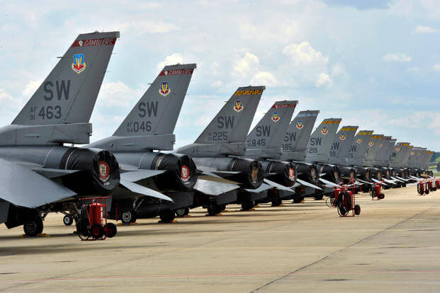 Several F-16's line up on the flight line in preparation for an Operation Readiness Exercise elephant walk at Shaw Air Force Base, S.C., May 21, 2012. (U.S. Air Force photo by Senior Airmen Tabatha McCarthy/released)