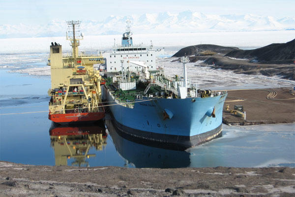 The Military Sealift Command-chartered tanker ship MV Maersk Peary, provides fuel to the National Science Foundation-chartered scientific-research vessel R/V Nathanial B. Palmer at McMurdo Station ice pier. (U.S. Navy photo)
