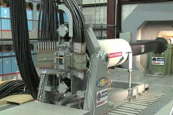 A test shot fires from the Office of Naval Research-funded Electromagnetic Railgun prototype launcher located at the Naval Surface Warfare Center Dahlgren Division. (ONR video screenshot by Jessica L. Tozer/Released)