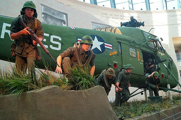 This new tableau depicts Marines heading for cover as they exit a Vietnam-era Sikorsky UH-34D helicopter during Operation Starlite in 1965. (National Museum of the Marine Corps photo)