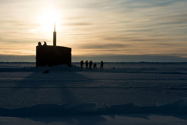 SS Hampton (SSN 767) surfaces through the ice in the Arctic Circle during Ice Exercise (ICEX). (Photo: Mass Communication Specialist 2nd Class Tyler Thompson)