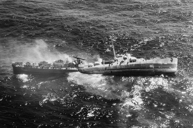 USS Fiske broken in two and sinking in the Atlantic Ocean on 2 August 1944, after she was torpedoed by the German submarine U-804. Note men abandoning ship by walking down the side of her capsizing bow section. (Photo: U.S. Navy)